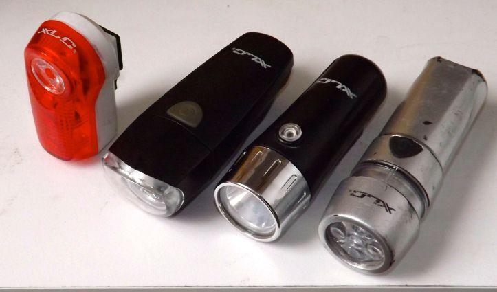 Mis luces XLC. De derecha a izquierda: versión urbana de 5 LEDs , Europa 1W, Europa 1W 2013, y, por último, una  Ultra 0.5W trasera.